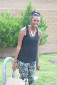 Tasha smiling in wrist soiree, silence + noise shirt and naomi rose jeans