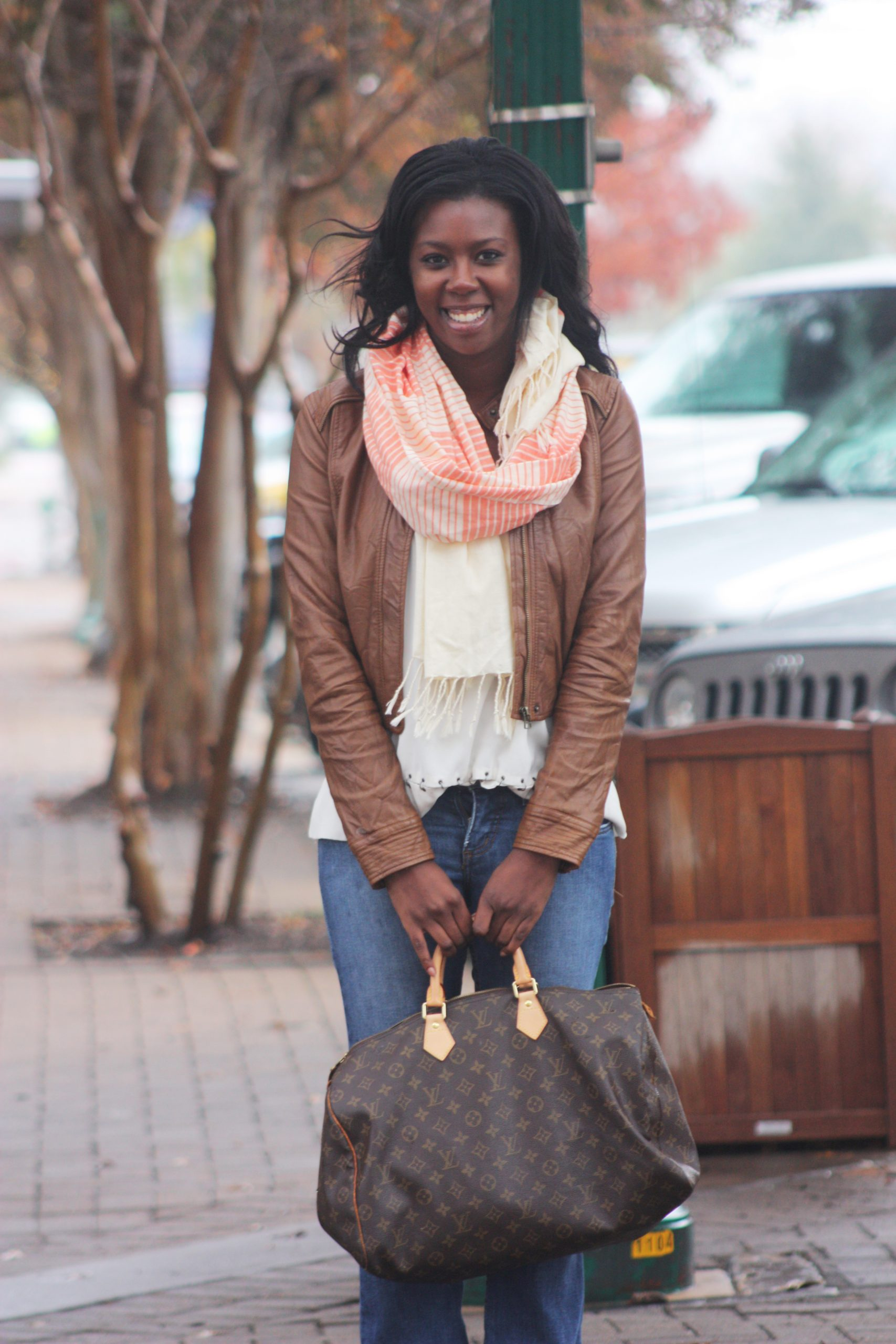 Tasha in Krama Wheel Scarf, Gianni Bini Blouse, Juicy Couture jeans, Vintage Louis Vuitton Speedy and Marco Santi Booties