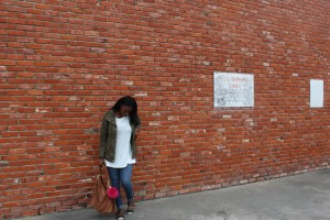 Tasha outside with army jacket and leopard flats. | Imperfect Concepts